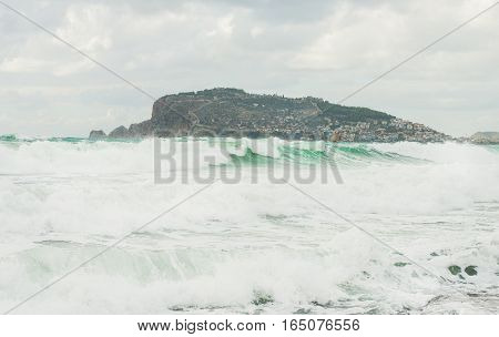 Stormy Mediterranean sea in Alanya, Turkey, in winter. View over Alanya castle hill and waves