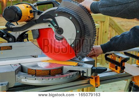 Man Cutting Wood On Electric Saw