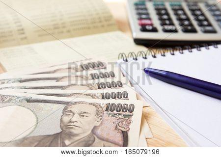 Saving account passbok japanese yen note book calculator and pen