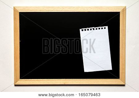 Note paper in black board with wood frame on white background