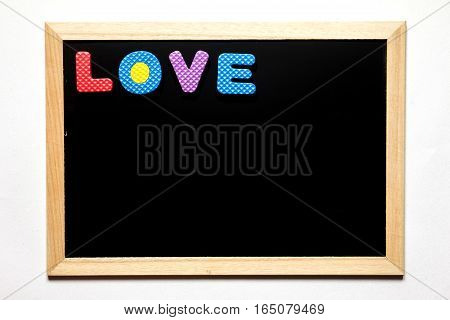 Black board with wording love on white background