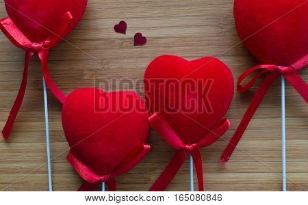 red velvet hearts on bamboo board with small hearts