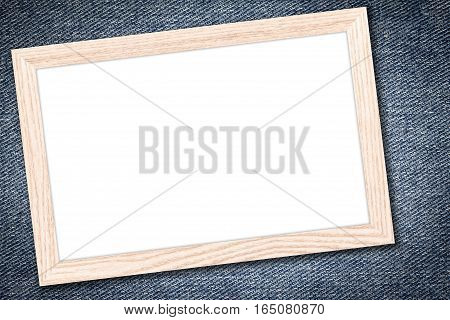 Whiteboard or Empty bulletin board with a wooden frame on denim jeans background with copy space for text or image.