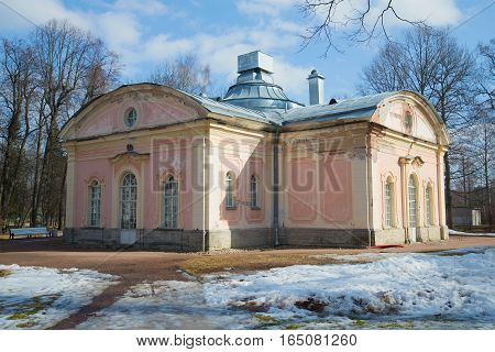 LOMONOSOV, RUSSIA - MARCH 27, 2016: The ancient building of palace kitchen in the park of Oranienbaum in the sunny March afternoon. Historical landmark