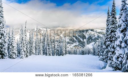 The village of Sun Peaks at the foot of the Ski Slopes in a Winter Landscape on the Hills in the Shuswap Highlands of central British Columbia, Canada