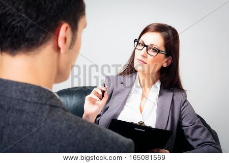 a man is talking to his psychologist.