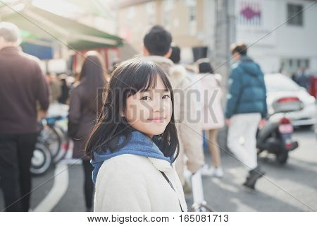Beautiful Asian girl walking in the city,Tsukiji fish market ,Tokyo Japan.