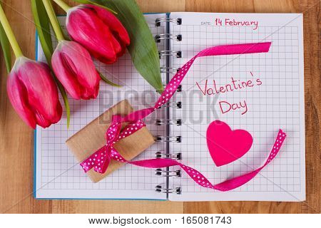 Valentines Day Written In Notebook, Fresh Tulips, Wrapped Gift And Hearts, Decoration For Valentines