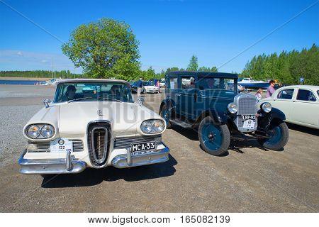 KERIMYAKI, FINLAND - JUNE 06, 2015: Cars Edsel Citation 1958 and Chevrolet 1928 on the parade retro transport