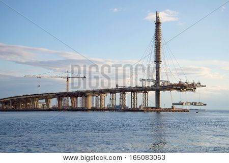 Installation of the last flight of the Western High-Speed Diameter Ring Road over the Gulf of Finland. Saint-Petersburg