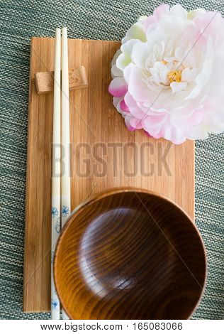 Japanese styled table settings with peony flower