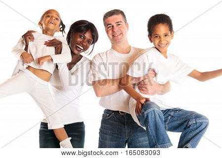 studio shot of african mother, european father and their children fooling around.
