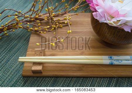 Japanese styled table settings with yellow artificial flowers