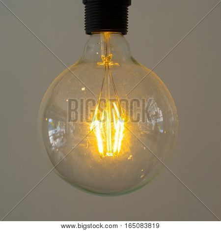 Incandescent lamps in a big modern cafe