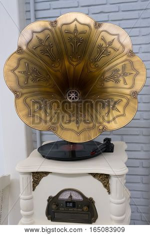 Vintage wind-up gramophone record player  in the big coffee