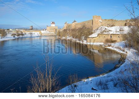 Boundary river Narva in the sunny March afternoon. Ivangorod, Russia