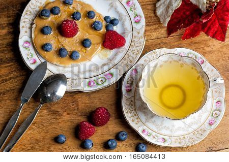 Cup Of Tea, Sauser, Rice Cracker With Peanut Butter, Berries And Honey On The Wooden Table