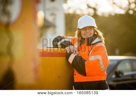 Portrait of senior woman engineer wearing protective workwear - outdoor