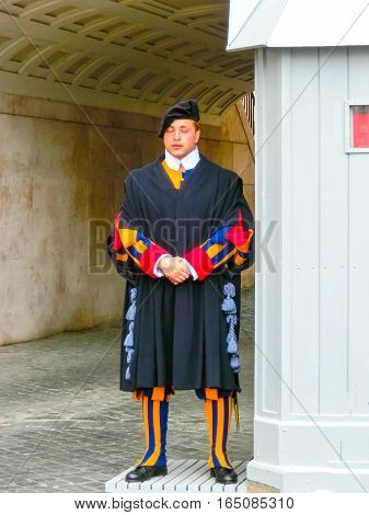 Vatican city, Rome, Italy - May 02, 2014: The Swiss guard standing on 2 May 2014 in Vatican City, Rome, Italy. Vatican City State is a sovereign city-state within the city of Rome