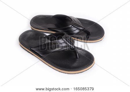 Black leatherette slippers for men on white background.