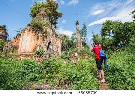 Tourist travel in the area of ancient pagoda named Shwe Indein located in the village near Inle lake of Myanmar.