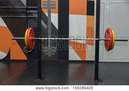 Rod With Weights In The Gym. Free Copyspace.