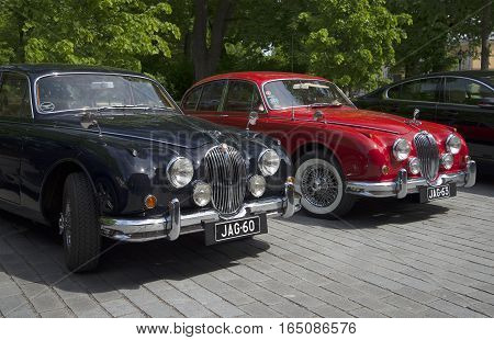 TURKU, FINLAND - JUNE 13, 2015: Two Jaguar Mk.-1 50-ies of the exhibition and parade of vintage cars. Turku, Finland