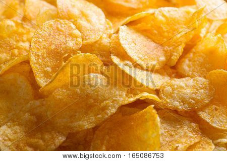 potato chips on old wooden background. potato chips.
