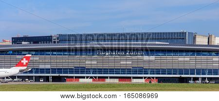 Kloten, Switzerland - 29 September, 2016: the main building of the Zurich Airport, view from the field of the airport. The Zurich Airport, also known as the Kloten Airport, is the largest airport in Switzerland.
