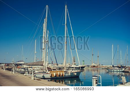 Pier With Yachts At Sea