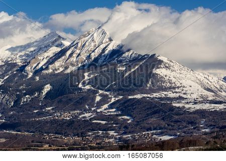 Petite and Grande Autane mountain peaks covered in winter snow. Saint Leger les Melezes Champsaur Hautes Alpes Southern French Alps France
