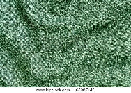 Green Color Denim Textile Cloth Surface.