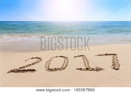 Year 2017 Written At The Sand Beach With Sea Wave Water