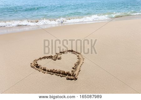 Heart Shape, Love Symbol Written At The Sand Beach