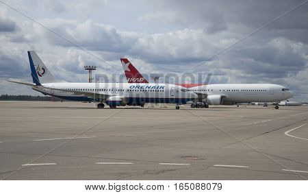 MOSCOW, RUSSIA - APRIL 15, 2015: Two of the parked aircraft under a cloudy sky. Sheremetyevo, Moscow