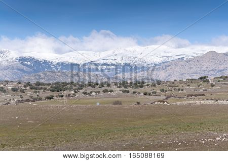 Views of Guadarrama Mountains from Colmenar Viejo, Madrid, Spain. It is a mountain range forming the main eastern section of the Sistema Central the system of mountain ranges at the centre of the Iberian Peninsula