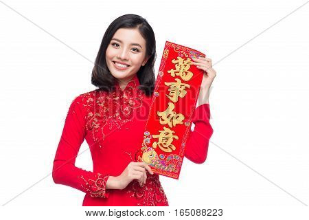Portrait of a beautiful Asian woman on traditional festival costume Ao Dai showing New Year scrolls Tet holiday. Lunar New Year. Text mean Happiness and Getting Rich.