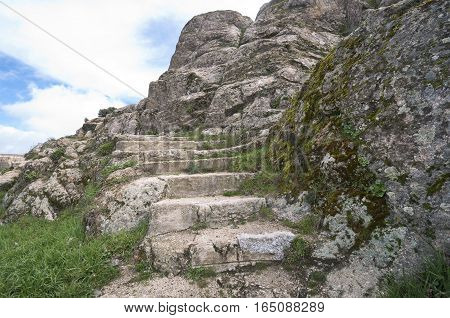 Stone stairs sculpted in granite rocks near River Manzanares, Madrid, Spain
