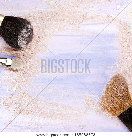 Makeup brushes on a light purple background, with traces of powder and blush on it. A square template for a makeup artist's business card or flyer design, with plenty of copyspace