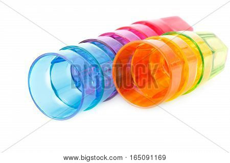 Colorful plastic glasses isolated on white background.