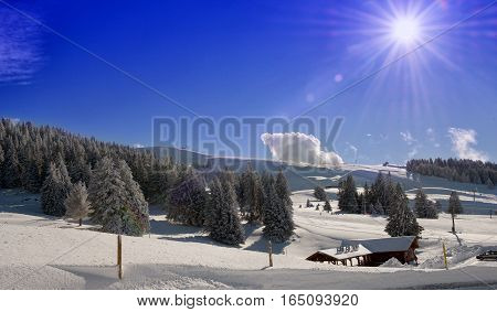 a winter mountain landscape in the french Alps