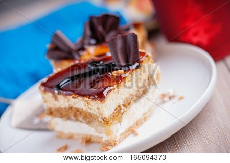 Pieces of cake and metal paddle on a whie dish