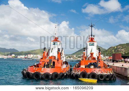 Two Orange Tugboats in St Maartin harbor