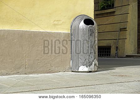dustbins trashcan trash can rubbish bin can outside against brick wall with copy space