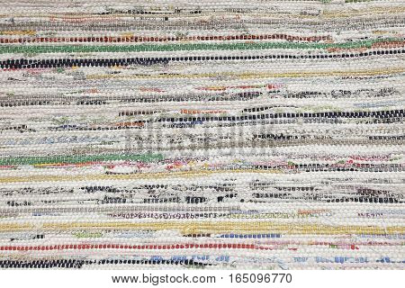 Textile Texture Close Up of Colrful Fabric Carpet or Doormat Pattern Background.