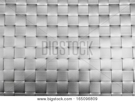 Background Pattern Silver Plastic Weave Texture Wicker Surface of Plate Mat.