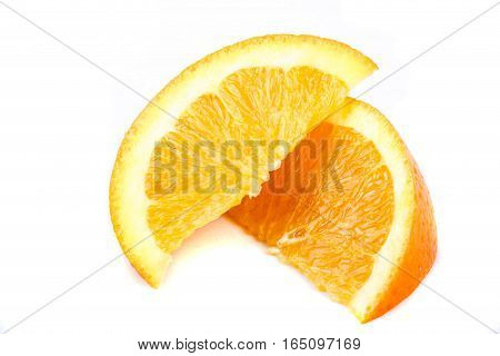 Two sliced segments of an orange isolated on white
