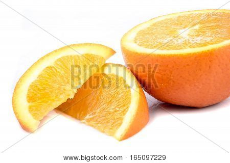 Half an orange isolated beside two segments