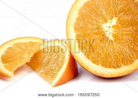 Half an orange isolated alongside two segments