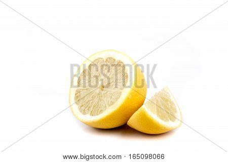 A sliced lemon isolated on a white background